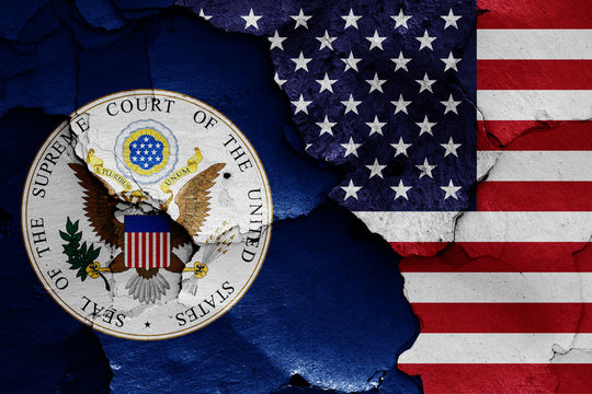flags of Supreme Court of the United States and USA painted on cracked wall