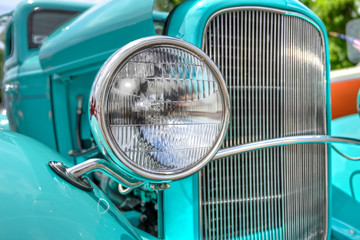 Poster Vintage cars headlight of a classic car
