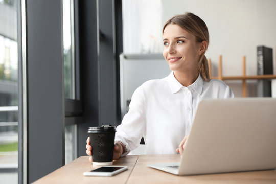 Female business trainer working with laptop in office