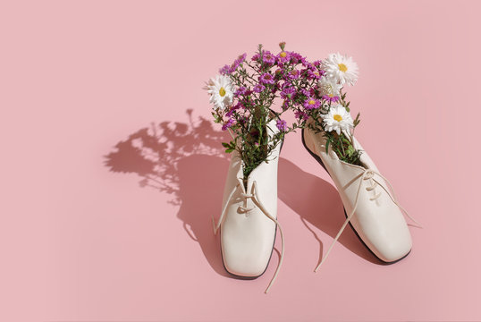 Comfortable women's shoes with flowers on a pastel background. Creative concept of fresh smell in shoes, healthy feet, summer sales.