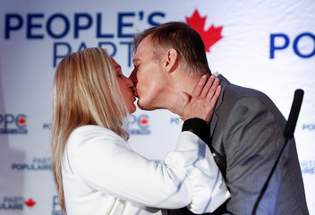 People's Party of Canada (PPC) leader Maxime Bernier kisses his wife Catherine Letarte after the announcement of federal election results in Beauceville