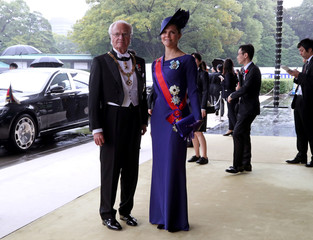 Sweden's King Carl XVI Gustaf and Crown Princess Victoria arrive at the Imperial Palace to attend the proclamation ceremony of the enthronement of Japan's Emperor Naruhito in Tokyo