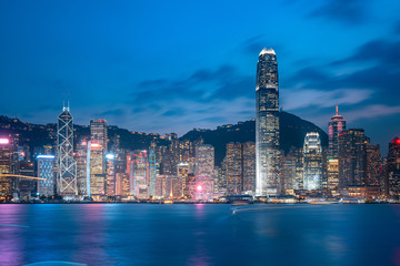 Fototapete - Cityscape and skyline at Victoria Harbour in Hong Kong city at Night