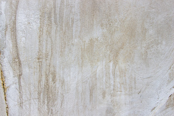 Cream concreted wall for interiors or outdoor exposed surface polished concrete. Cement have sand and stone of tone vintage, natural patterns old antique, design art work floor texture background. Wall mural