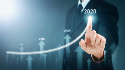 Man standing and pointing hand with Arrow and Line Visual Graphic on Light of Len flare and Boke blue background. COPY SPACE. Business Concept : Market Uptrend and Forecast 2020