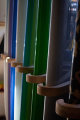 shiny colorful new surf boards stacked