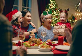family celebrating Christmas Wall mural