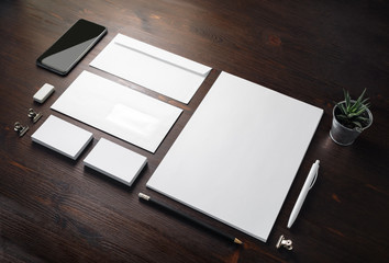 Photo of blank stationery set on wood table background. Corporate identity template. Responsive design mockup.