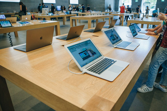 Berlin, August 29, 2018: Retail sale of new MacBooks in the official store of Apple in Berlin. Modern and stylish laptops.