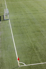 Soccer field with goal and red flag
