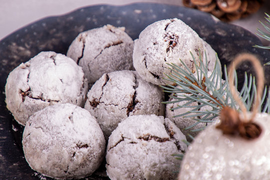 Traditional Christmas almond chocolate snowballs cookies biscuits covered icing sugar powder. Russian Tea Cakes, Mexican Wedding Cookies, Butterballs. Christmas New Year festive ornament decorations.