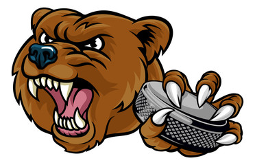 A bear ice hockey player animal sports mascot holding a hockey puck