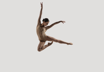 Modern ballet dancer. Contemporary art ballet. Young flexible athletic woman.. Studio shot isolated...