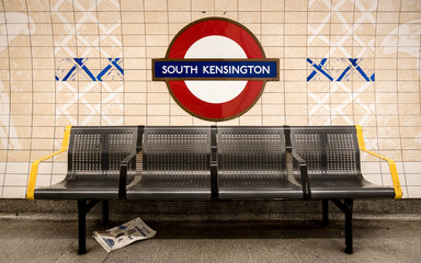 South Kensington tube station, London. The London Underground roundel sign for the West London district known for its museums and gardens.