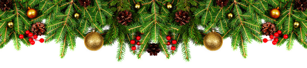 Fotobehang Groene Amazing christmas border with fresh fir branches isolated on white. Golden balls, fir branches and red berries composition.