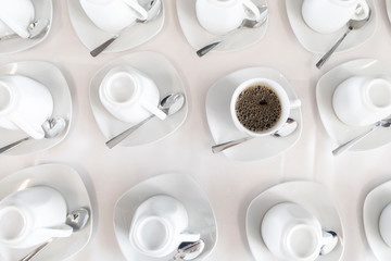 Coffee cups at a catered buffet table