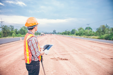 Construction using check GPS distance by tablet.and distance measure wheel on the road