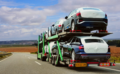 The trailer is engaged in the delivery of new cars to their place of sales