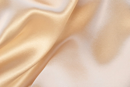 Shiny beige luxury silk background