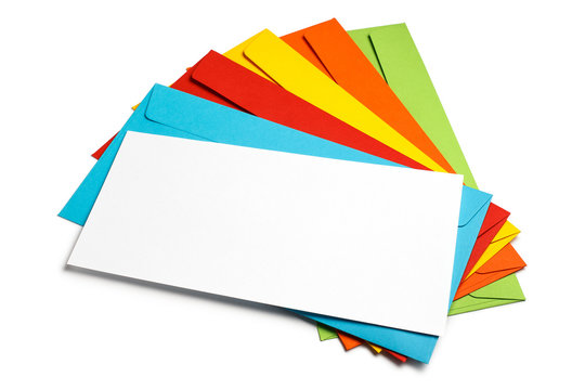 Blank white paper on a stack of multicolored envelopes, isolated on white background