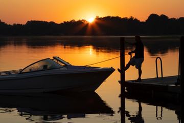 Fisherman departing in a small powerboat at dawn for a day of adventure in a Florida lake.