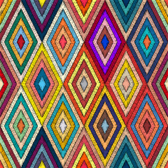 Embroidered geometric seamless pattern. Handmade in bohemian style. Patchwork hand-drawn ornament. Pricn for textiles, wrappers, carpets. Ethnic and tribal motifs. Vector illustration.