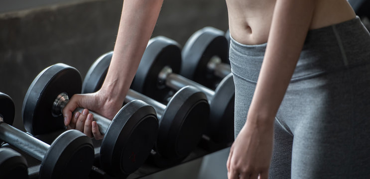 Workout woman with weight lifting for lean body and body slim shape building.