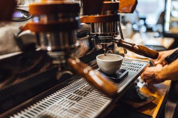 Espresso machine in close up, barista making coffee