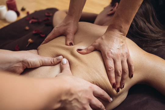 Sensual Tantric Massage in four hands in the cozy atmosphere of a professional masseur Beauty