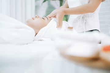 Poster de jardin Spa Beautiful young woman lying down on beds massage and spa at asian spa massage and beauty salon center, spa concept, massage concept