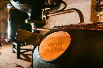 Canvas Prints Bar Detalis of medieval traditional distiller cube made from copper production of alcohol, cognac, whiskey. Fragment of copper old distiller for alcohol production. Ancient traditional food technologies