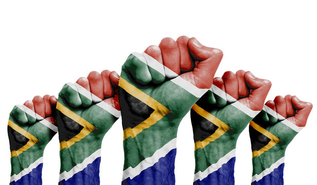 A raised fist of a protesters painted with the South Africa flag