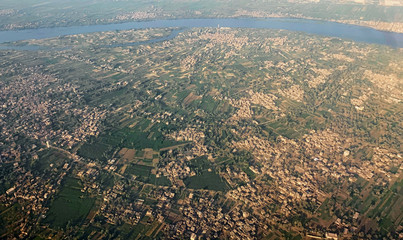 A general view shows the Nile River, houses and agricultural land seen from the window of an airplane, in Luxor