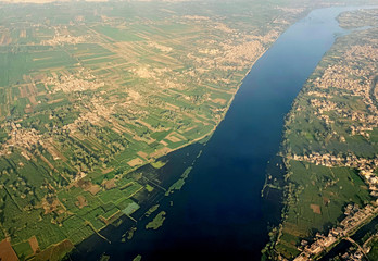 A general view of The Nile River, houses and agricultural land from the window of an airplane in Luxor