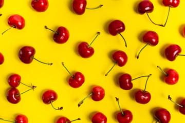 Fresh cherry fruit on yellow background