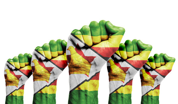 A raised fist of a protesters painted with the Zimbabwe flag