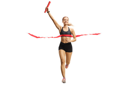 Athlete woman finishing a relay race with a baton in her hand