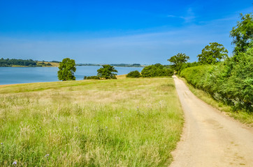 Track leading towards Rutland Water a large reservoir in Leicestershire.