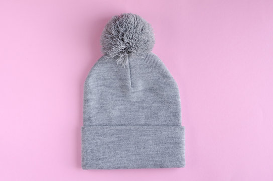 Gray cotton hat composition on pink background. Flat lay.