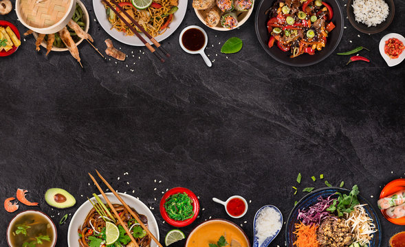 Asian food background with various ingredients on rustic stone background , top view. Vietnam or Thai cuisine.