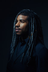 Portrait of man with long dreadlocks