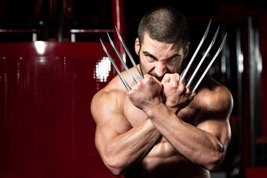 Superhero With Claws Flexing Muscles in Fitness center