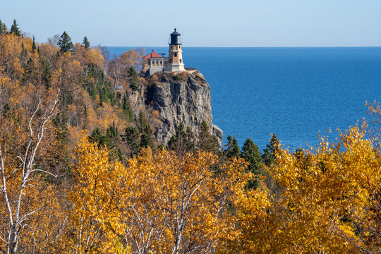 Autumn fall leaves with Split Rock Lighthouse in the distance on Lake Superior Minnesota