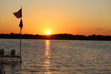lake sunset with flags