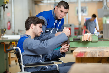 portrait of young handicapped carpentry apprentice