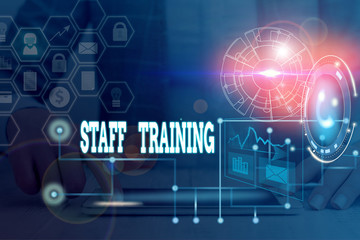 Writing note showing Staff Training. Business concept for program that helps employees learn specific knowledge Picture photo network scheme with modern smart device