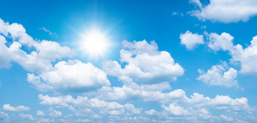 Beautiful blue sky with white clouds and sun