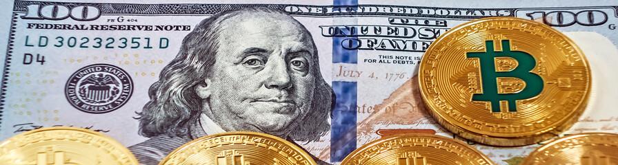 Gold bitcoin coin one hundred dollars bills.