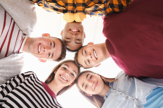 Portrait of teenagers on white background, bottom view