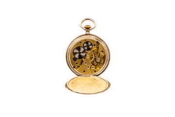 Old antique mechanical golden steel pocket watch with open lid isolated on white background.